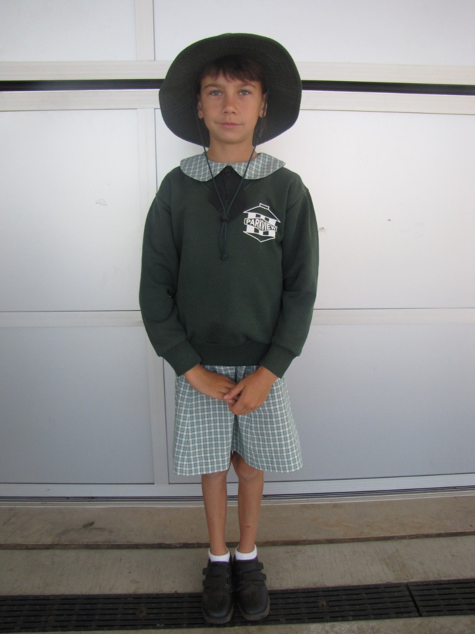 Girls Summer uniform with jumper and hat.